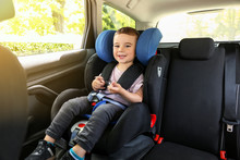 Baby Boy Buckled In Car Seat
