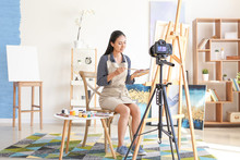 Female Asian Blogger Recording Video In Workshop
