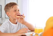 Funny Little Boy Eating Tasty ...
