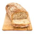 Leinwandbild Motiv Homemade loaf of bread on plank isolated on white background