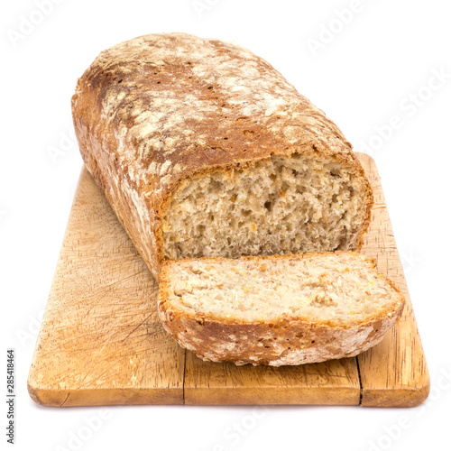 Homemade loaf of bread on plank isolated on white background Fototapeta