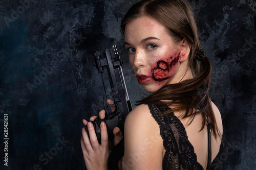 Photo  Strong independent woman with gun in her hand