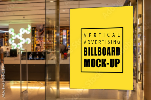 Fotomural  Mock up vertical signboard on glass panel of record store