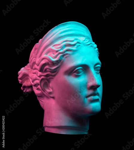 Photo Gypsum copy of ancient statue Diana head isolated on black background