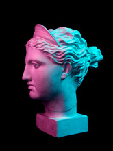 Gypsum Copy Of Ancient Statue Diana Head Isolated On Black Background. Plaster Sculpture Woman Face.