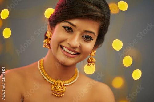 Beautiful Indian young women portrait with jewelry Canvas Print