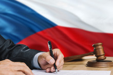 Judge Writing On Paper In Courtroom With Czech Republic Flag Background. Wooden Gavel Of Equality Theme And Legal Concept.