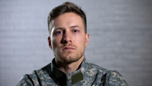 Crying Male Soldier Looking At Camera, Military Posttraumatic Syndrome, Problem