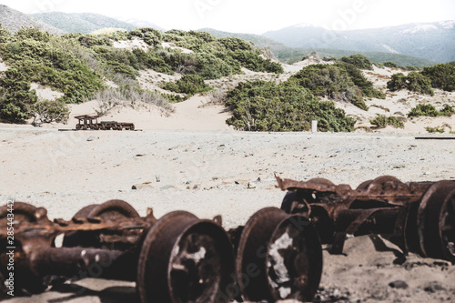 Old Mine Carts on the beach - Piscinas Sardegna Wallpaper Mural