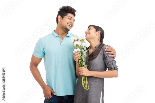 Beautiful young couple holding bunch of white flowers Wallpaper Mural