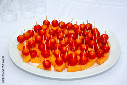 appetizers on the buffet table with  tomato melon Wallpaper Mural