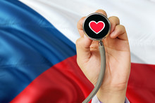 Doctor Holding Stethoscope With Red Love Heart. National Czech Republic Flag Background. Healthcare System Concept, Medical Theme.