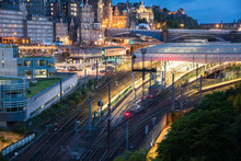 View From Above Of Railroad Tracks And A Train Station In A City Centre At Dusk. Edinburgh, Scotland.