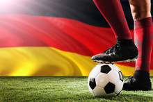 Close Up Legs Of Germany Football Team Player In Red Socks, Shoes On Soccer Ball At The Free Kick Or Penalty Spot Playing On Grass.
