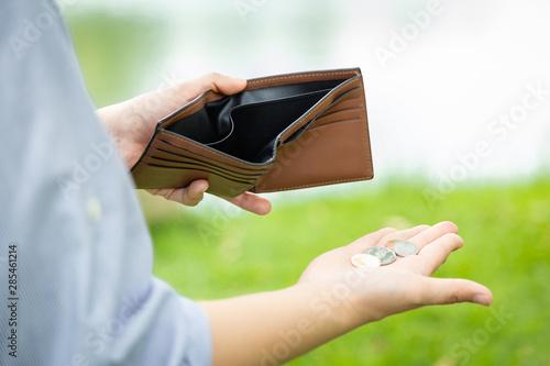 Closeup hand of asian businesswoman holding her wallet,hand open an empty wallet Canvas Print