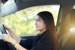 Asia woman driving a car