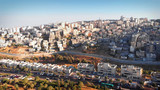 Palestinian Town Behind concrete Wall Aerial view Flying over Palestinian Town Shuafat Close to Jerusalem Drone footage