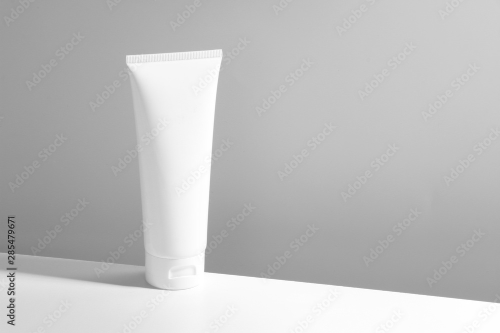 Fototapeta beauty skincare cosmetic mockup cream lotion bottle pakage on white background, sunscreen protection