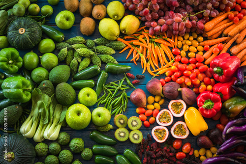 Poster Cuisine Different fresh fruits and vegetables flat lay on table top, Various fresh vegetables organic for eating healthy and diet