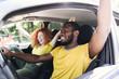Interracial couple having fun on a car trip