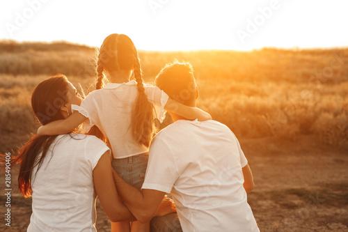 Anonymous family admiring sunset Wallpaper Mural