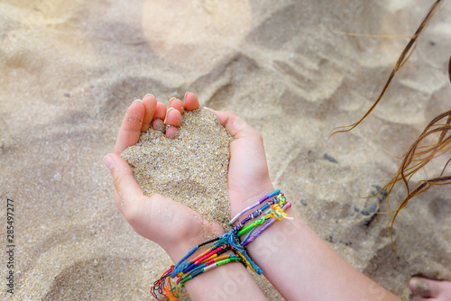 pretty heart of sand in the hands of a girl Poster Mural XXL