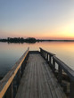 Empty wooden bridge at sunset. Soft sunlight