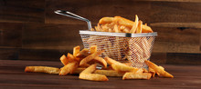 Tasty French Fries Potato On Wooden Table Background