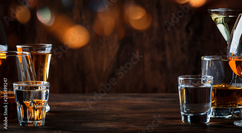 Foto auf Leinwand Alkohol Strong Spirits Set. Hard alcoholic drinks in glasses in assortment: vodka, cognac, tequila, brandy and whiskey, grappa, liqueur, vermouth, tincture, rum.