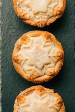 Top View Of Three Mince Pies With Snowflake Ornament