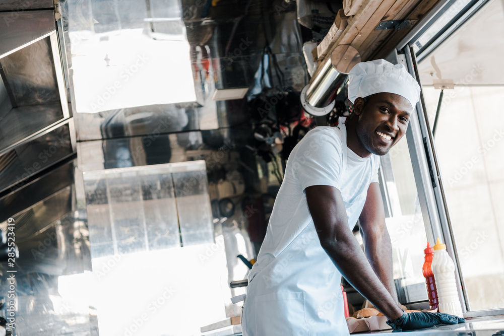 Fototapety, obrazy: selective focus of happy african american chef smiling in food truck
