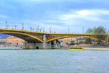 Budapest, Hungary Bridge And Water Bus Or Amphibian Transport At Danube River And City Background