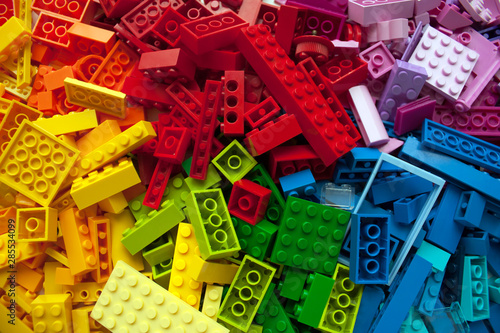 Photo Pile of child's building blocks in multiple colours
