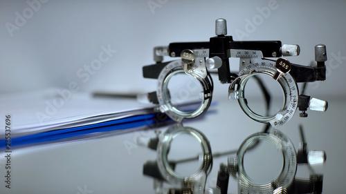 Fotomural  Prescription folder and optical trial frame for vision checking lying on table