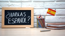 Do You Speak Spanish Written On Board, International Flag In Box, Language