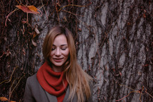 Portrait Of Smiling Woman With Eyes Closed In Autumn