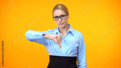 Disappointed female boss showing thumbs down, project failure, mistake gesture Tablou Canvas