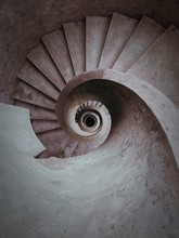 A Spiral Stone Staircas Going Down.