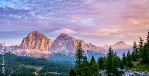 Panoramic view of famous Dolomites mountain peaks glowing in beautiful golden evening light at sunset in summer, South Tyrol, Italy. Artistic picture. Beauty of mountains world