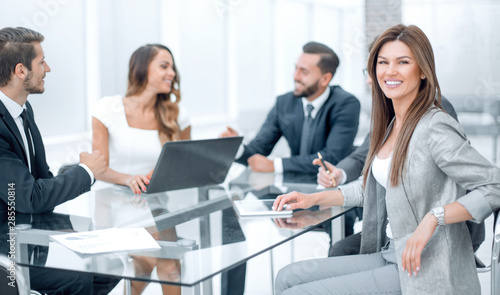 Obraz business team discusses new ideas at a business meeting - fototapety do salonu
