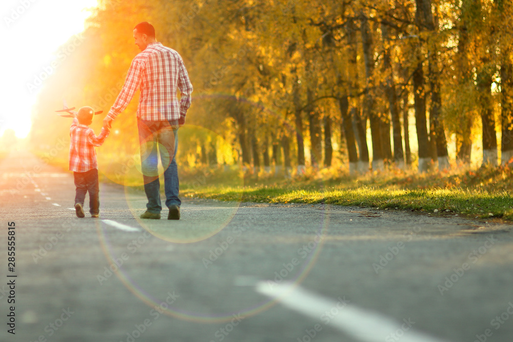 Fototapety, obrazy: happy father and son go along the road