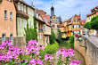 Leinwandbild Motiv Picturesque old buildings and flowers lining a canal in the town of Marktbreit, Bavaria, Germany