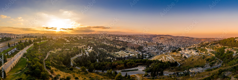 Fototapeta Aerial sunset view of Jerusalem  with the old city and the western parts, Silwan, Rehavia, Abu Tor and talpiyot