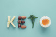 Keto word made from Ketogenic diet, low carb, healthy food on blue pastel background