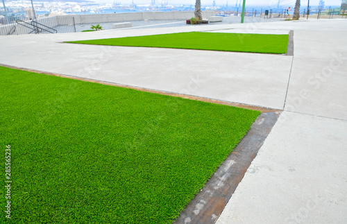 City landscaping technique with artificial turf surface.