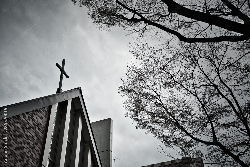 Fototapeta Cross on the church roof On a cloudy day.