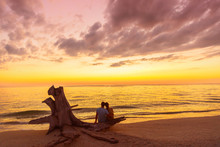 Couple On Beach At Sunset Silh...