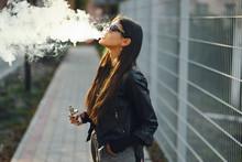 Stylish Girl Smoking An E-ciga...