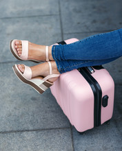 Travel Feet On Suitcase Luggage. Trip Vacation Or Holiday Tourism Concept. Woman Legs On A Suitcase. Resting Tourist.
