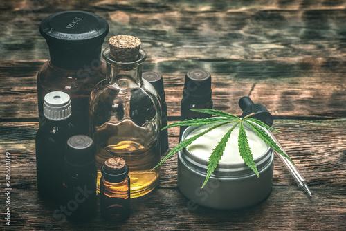 Fototapeta Cannabis face cream or moisturizer jar and cbd oil bottles concept. obraz